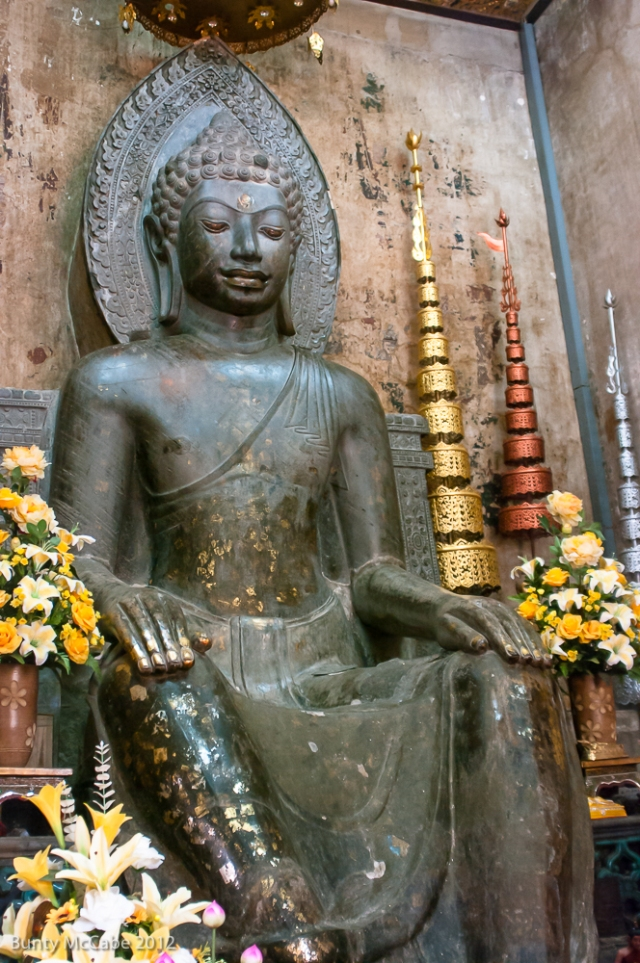 Seated Buddha Image in the style of the Dvaravati culture. Quite unusual seated position (in what is often called the European way of sitting).