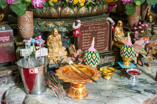 Under the seated Buddha, these offerings.